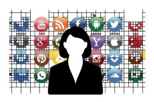 Female figure in front of social media icons