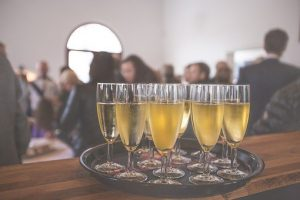 Champagne glasses on a tray - Christmas Party Perils for Employers